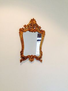 Petite vintage mirror: cast iron original with gold hand painted finishing. Approximately 300mm H x 200mm W [please note that pricing is currently
