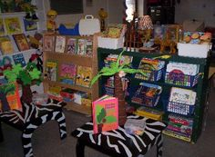 jungle theme classroom | Twist brown or green paper into vines and hang from the ceiling.