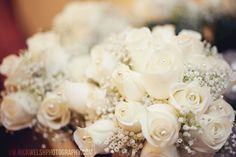 Wedding bouquets of white roses, baby's breath, and pearls - www.nickwelshphotography.com