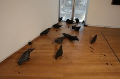Murder of crows made out of burnt wood.