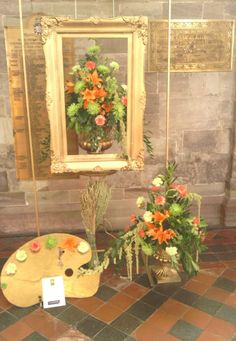 One of my favourite displays A floral arrangement based on work inspired by artists featured in a book by the Dean of Hereford 'Saints & Sinners of the Marches'