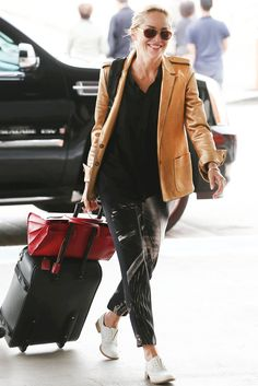 Sharon Stone in graphic print pants and a blazer. (I always try doing that thing she's doing with her red bag and carry-on luggage - but my bag always slips off)