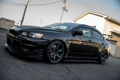Tarmac Black CZ4A EVO X with VARIS goods Mag Blue Volk TE37 Ultras, farting out a BLITZ Nur Spec exhaust..