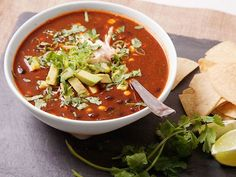 The mild heat of this hearty ancho chili-based soup is balanced by sweet corn and black beans.