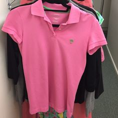 Lilly Pulitzer pink polo shirt Lilly Pulitzer pink polo shirt. Never worn Lilly Pulitzer Tops