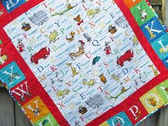 Who doesnt love Dr Seuss? This unisex babyquilt is made from the latest Dr Seuss ABC collection. It has been quilted in white thread in a cat in the