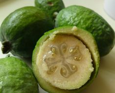 There is nothing quite like a feijoa – they are simply the most amazing fruit. Fragrant, pungent, sweet yet sour, gooey in the middle and grainy round the edges. The original yum in a small green torpedo. Fresco, Herbal Leaves, Permaculture Courses, Exotic Fruit, Best Fruits, Fruit And Veg, Medicinal Plants, Fruit Trees, Health Remedies