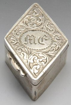 A Victorian silver snuff box of diamond form, Hallmarked T H Hazlewood & Co, Birmingham 1897.