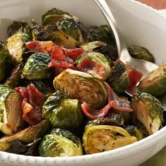 Preheat oven to 400 degrees F. Cut large Brussels sprouts into lengthwise quarters or cut small sprouts in half. In a large bowl toss together sprouts, 1 tablespoon of the vinegar, and the oil until sprouts are lightly coated. Sprinkle with pepper and salt; toss to coat.