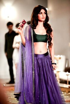 Priyanka Chopra in purple net lehanga and dupatta with a green sleeveless silk blouse.
