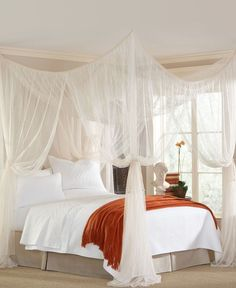 Undeniably romantic, the Majesty canopy takes you away with sweeping panels of sheer mosquito netting. Hang above the bed, or around a sitting area in or outside... it's up to you! Easily hangs from ceiling or four poster bed for a look of regal proportions.: