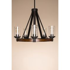 The distressed wood frame and riveted black metal of this Kichler ...