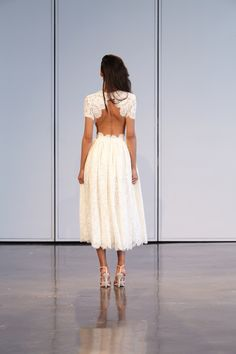 In love with this open back, tea length, lace wedding dress