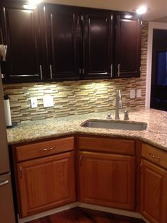 """""""Gel staining my kitchen. The bottom is the old golden oak and the top is the new java stain. Looks a 1000 times better and updates the kitchen with very little money."""" General Finishes Java Gel"""