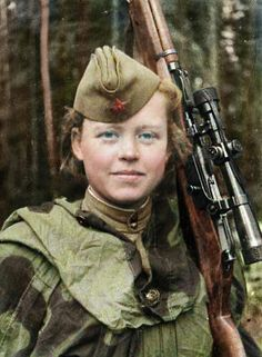 "Sniper volunteer Nadezhda Kolesnikova. 19 confirmed kills, awarded the medal ""For Courage"". Volkhovsky front, 1943"