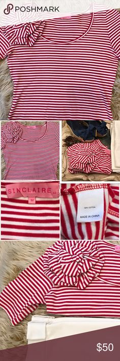 """Sinclaire 10 from Neiman Marcus Size M EUC Sinclaire 10 red/white striped scoop neck short sleeve top with 3-D flower appliqué. Very French-like when paired with listed Sinclaire 10 wide leg cuffed trousers!  EUC. No Flaws! Like New. Measured lying flat: collar opening 9"""", shoulder to shoulder 14.5"""", bust 18.5"""", waist 15"""", sleeve length 11"""", hem width 18"""". Fitted but not tight! Thick high quality fabric. Absolutely adorable!!!! Purchased at Neiman Marcus about 8 years ago and wore twice…"""