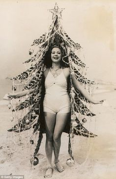 A beauty queen dressed as a Christmas tree during a photo shoot in 1930s California.