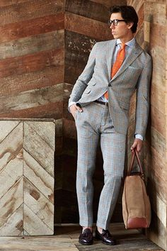 Dress in a grey tartan suit and a baby blue vertical striped dress shirt for a sharp classy look. Why not add dark brown leather tassel loafers to the mix for a more relaxed feel? Shop this look on Lookastic: https://lookastic.com/men/looks/suit-dress-shirt-tassel-loafers-tote-bag-tie-pocket-square-belt/9216 — Light Blue Vertical Striped Dress Shirt — Mint Pocket Square — Orange Tie — Dark Brown Woven Leather Belt — Grey Plaid Suit — Brown Suede Tote Bag — Dark Brown Leather Tassel...