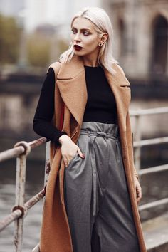 Outfit: Casual Business via Masha Sedgwick   wearing a classy red bag from Aigner, wide grey marlene trousers from Carin Wester, black crop top, a brown wool vest   street style from Berlin   effortless chic