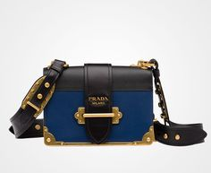 Prada Cahier calf leather bag Leather shoulder strap embellished with bronze studs Bronze hardware Bronze lettering logo Lace closure on the front Two inside compartments and two inside pockets, including one with flap Nappa leather lining Bags Online Shopping, Online Bags, Shopping Bag, Handbag Online, Prada Handbags, Prada Bag, Barbeau, Prada Cahier Bag, Dior