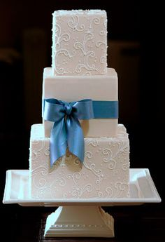 Square, white wedding cake with ribbon! And with a purple ribbon to match my theme colors