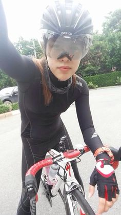 Cycling pants. She is taking a selfie
