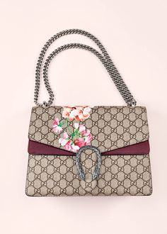 Gucci Dionysus: A new handbag collection, Dionysus combines the House's signature motif with modern accents, like contrast suede insets, an adjustable chain strap and antiqued tiger-head spur. Other iterations feature the season's blooms print and nature-inspired appliqués—handcrafted by wrapping silk threads around thin brass wires.