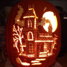 Haunted House pattern by Stoneykins. Carved on a foam pumpkin by WynterSolstice