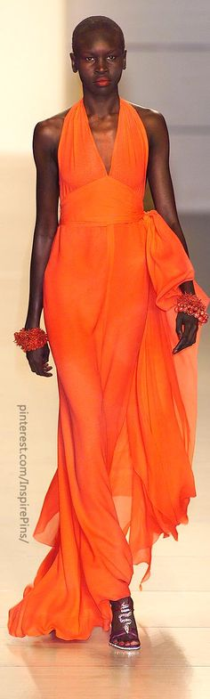 Alek Wek modelling Valentino at Paris Spring 2001, wearing this summer's must-have lipstick colour. She can do no wrong.