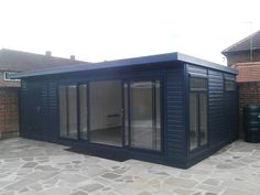 16x12 + 4x12 combination summer house painted in 'Anthracite' and featuring colour matching sliding doors. (search for 5275 for more details)