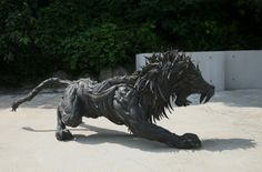 *OMG I want this in my garden! *  Pictured above is a lion sculpture that Ji created. It uses the rubber from old tires as its medium and it took him three months to complete.