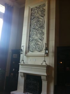 Great idea for use of large space over a 2 story family room fireplace...faux iron design