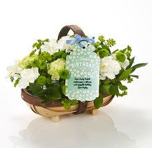 """The happiest of birthdays! Deliver this unique trug of creamy white blooms to their door for an extra-special surprise. And don't forget: we'll add your carefully chosen words to the """"Happy Birthday to you"""" swing tag - for free! """"Happy Birthday to you"""" will be printed on the tag as well as your personal message."""