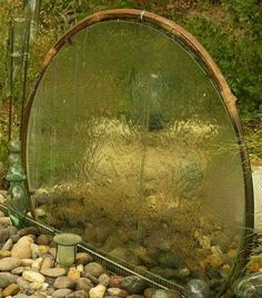 Stargate! Portal to another world water feature!  Repurpose of an old glass table!