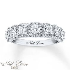 A sparkling row of round diamonds is haloed by dazzling smaller diamonds in this treasured Neil Lane Bridal® anniversary band for her. The ring is crafted of white gold and has a total diamond weight of 1 carats. Anniversary Bands For Her, Diamond Anniversary Bands, Anniversary Jewelry, Diamond Bands, Wedding Anniversary Rings, Vintage Gold Engagement Rings, Yellow Engagement Rings, Solitaire Engagement, Antique Diamond Rings