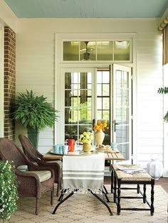 Love the bench seating for porch dining