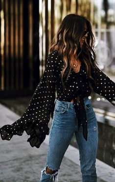Black polka dot top and high waisted jeans  Street style, street fashion, best street style, OOTD, OOTD Inspo, street style stalking, outfit ideas, what to wear now, Fashion Bloggers, Style, Seasonal Style, Outfit Inspiration, Trends, Looks, Outfits.