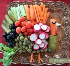 I love this, because my family has a tradition of making a veggie turkey every year for Thanksgiving, so this is just perfect! Easy fun food vegetable tray for the holiday.