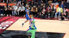 #NBA  TORONTO, ON - FEBRUARY 13:  Aaron Gordon of the Orlando Magic dunks over Stuff the Orlando Magic mascot in the Verizon Slam Dunk Contest during NBA All-Star Weekend 2016 at Air Canada Centre on February 13, 2016 in Toronto, Canada. NOTE TO USER: User expressly acknowledges and agrees that, by downloading and/or using this Photograph, user is consenting to the terms and conditions of the Getty Images License Agreement.  (Photo by Vaughn Ridley/Getty Images)