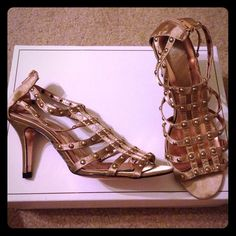 CLN Gold Studded Strappy Shoes Never worn. NWOB. Has zip up closure at the back and with gold studs on straps. Has 3-inch heels.Pricing low doesn't mean it's worth any less than the others or it has any flaws. Just offering a good deal to have more space in my closet. CLN Shoes Sandals