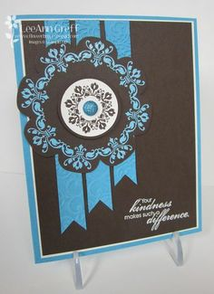 "Stamps - Daydream Medallions, Blooming with Kindness  Ink - Versamark, Early Espresso  Card stock - Tempting Turquoise, White, Early  Espresso  Accessories - Turquoise & White embossing powder, heat gun, embossing buddy, Brights glimmer brads, Lacy Brocade embossing folder, Big Shot, 1 1/4"" and 1 3/8"" circle punches, dimensionals"