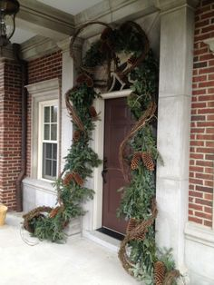 Christmas front door & entry decor - evergreen garland, grapevine, large pinecones, lights