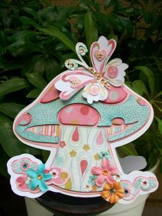 I really like this mushroom cut from Cricut's Tinker Bell and Friends cartridge. I like this colour combo too.