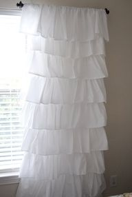 Make your own expensive looking ruffled curtains using $4 flat sheets from Walmart!