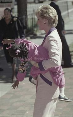 5th; October 1990. While visiting Grandma's House, a Washington, D.C. refuge for children with the AIDS virus, Britain's Princess Diana reached out to a three year-old girl, the home's unofficial goodwill ambassador, whom aides call the First Lady.
