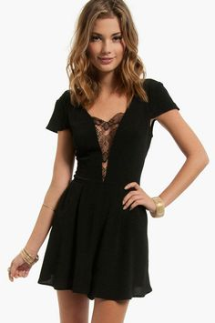 deep-v neck dress. i love the lace to cover up the cleavage.