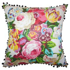 Showcasing a floral motif and pompom trim, this cotton pillow adds a pop of garden-inspired style to your sofa or bed.   Product: