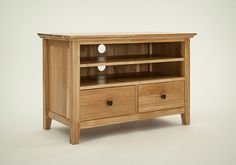 Hereford Rustic Oak Small TV Unit - The Hereford Rustic Oak Small TV Unit is crafted from solid American white oak and has a lacquer finish which protects the piece against wear and tear. This product has a shelf at the top which is adjustable to three different heights and creates two useful spaces for a DVD player and Sky Box.