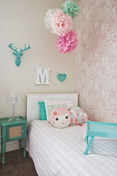 Millie Moo - My daughter Millie is a happy free spirited 8 year old who likes to fill up her room with Barbies, American Girl dolls and Harajuku perfume. This quirky pastel turquoise and pink themed room reflects her personality to a tea! Girls room interior designs by Little Liberty