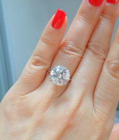 5.318 carat H VS2 ideal-cut diamond solitaire ring